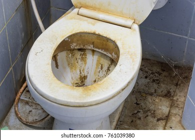 Dirty and stains on toilet bowl