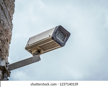 dirty surveillance camera with dust cover on the front element