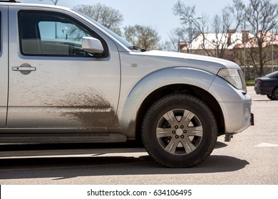 The dirty SUV gray color  with dirty a driver's door.