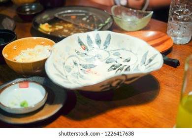 Dirty table dinner with food scraps after eating Japanese food