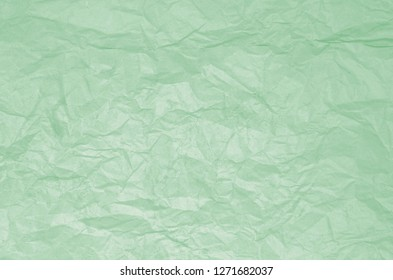 Dirty texture of old crumpled light green paper. Paper textures crumpled backgrounds for design