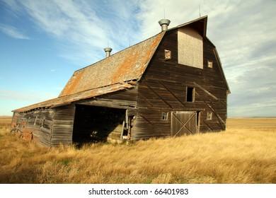 Dirty thirties depression era dilapidated barn sits abandoned on the prairies of Saskatchewan Canada
