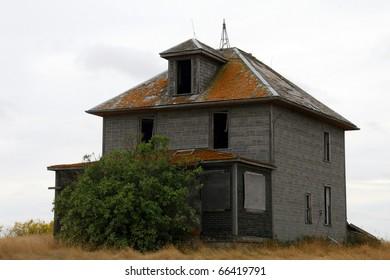 Dirty thirties depression era dilapidated farm house sits abandoned on the prairies of Saskatchewan Canada