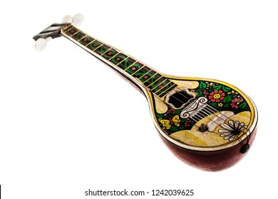 a dirty toy bouzouki isolated over a white background
