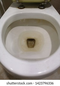 Dirty unhygienic toilet bowl with limescale stain. Selected focus and selected view image.