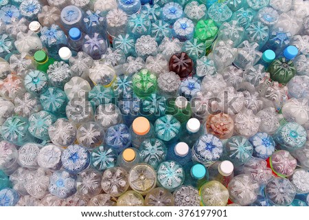 Dirty used colored plastic bottle pile ready to be recycled