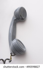 dirty vintage gray handset with peeling paint and expose wired