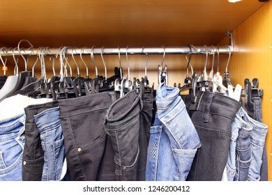 Dirty wardrobe with various women's clothes