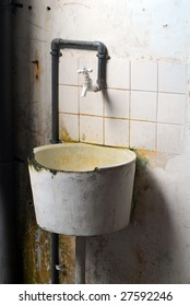 dirty washbasin with faucet in deserted tsunami house