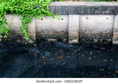 Dirty waste dark black stink bad water smell from city under water pollution process sewer drain pipe dirt sewage water drain to Wastewater Treatment with poor ecosystem and circular economy.