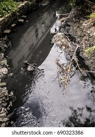 dirty water in slum, crowded city