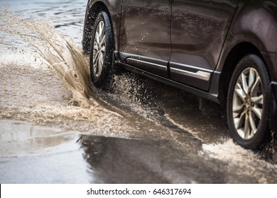 dirty water splash after vehicle roaring by
