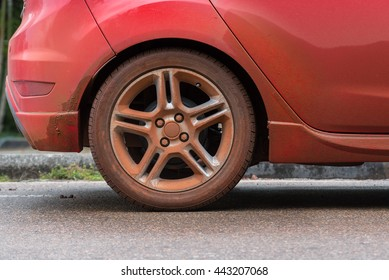 Dirty wheel of red car
