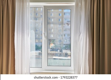 Dirty window in apartment. Unwashed dusty glass, city street view background. Unclean double glazed window