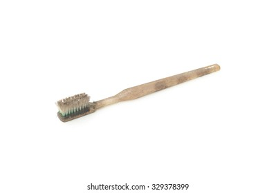Dirty and worn out toothbrush isolated on white background