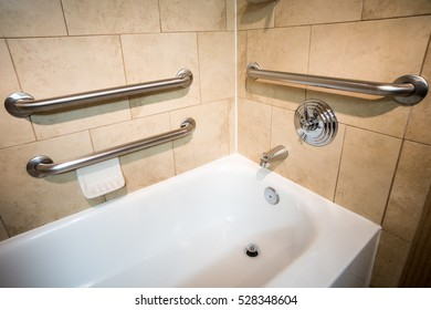 Disability Access Bathtub in a Hotel Room with Grab Bar Hand Rails