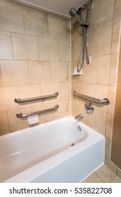 Disability Access Bathtub Shower in a Hotel Room with Grab Bar Hand Rails