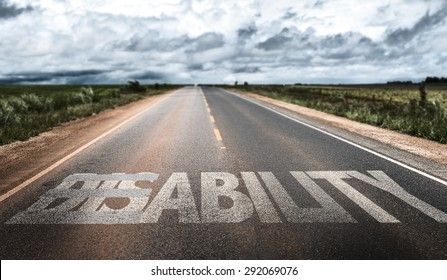 Disability/Ability written on rural road