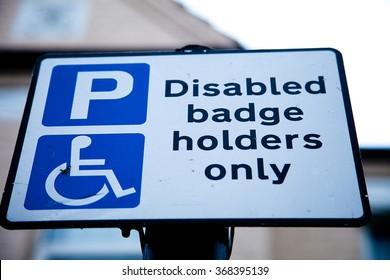 Disable badge holder parking road sign
