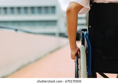 A disable man on wheelchair. People with disabilities can access anywhere in public place with wheelchair,that make them independent in transportation and feel they are not the stranger from social.