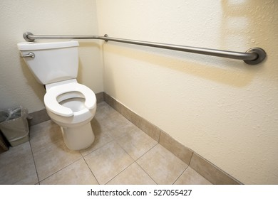 Disabled Access Toilet and Grab Bar Railing in a Hotel