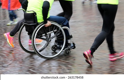 disabled athlete with the wheelchair during a competition, motion blur