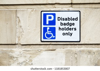Disabled Badge Holders Only at Car Park Sign on Wall