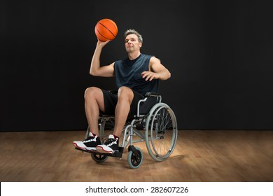 Disabled Basketball Player On Wheelchair Throwing Ball