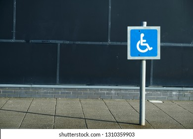 Disabled Blue Badge Holders Only at Car Park Sign Post