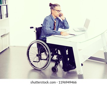disabled business man in wheelchair working  in the office