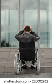 A disabled businessman having problems with getting to workplace