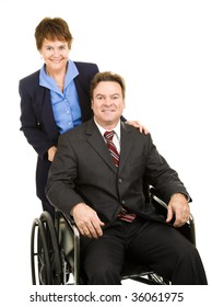Disabled businessman in a wheelchair, pushed by a female partner or assistant.  Isolated on white.