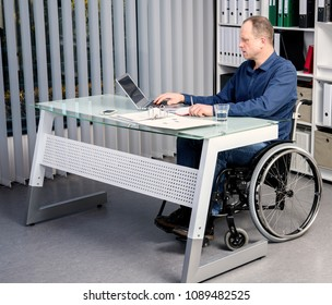 disabled businessman in wheelchair working in the office