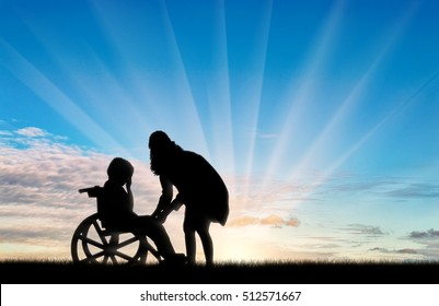 Disabled child in wheelchair crying and his mother day. Concept of disability