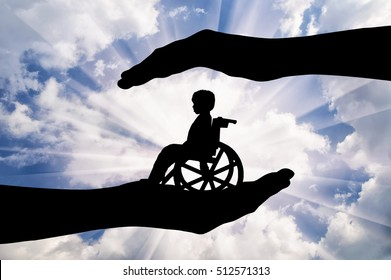 Disabled child in a wheelchair in the hands of man. Concept of care and custody