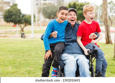 Disabled father play with his sons