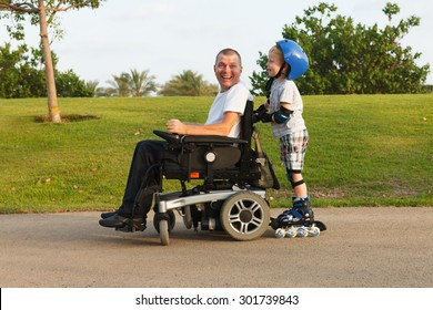 Disabled father rollerblading with son