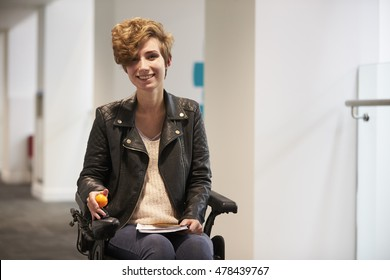 Disabled female university student smiling to camera