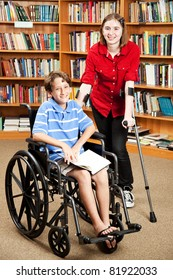 Disabled girl and boy in the school library.