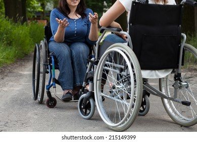Disabled girls during conversation on the street