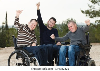 Disabled Happy friends  with thumbs up.