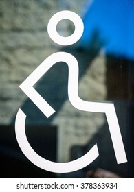 disabled icon sign  wheelchair handicap symbol - on the glass