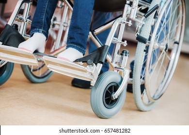 Disabled Kid on a Wheelchair Closeup Photo. Children Hospital Theme.
