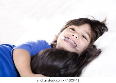 Disabled little boy hugging