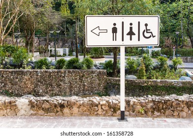 Disabled, male and female toilet sign in public park