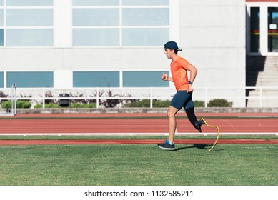 Disabled man athlete training with leg prosthesis. Disabled Sport Concept