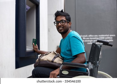 disabled man at the cash machine