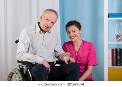 Disabled man and his nurse in a hospice