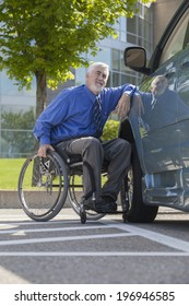 Disabled man in his wheelchair leaning on his accessible van
