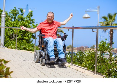 Disabled man on electric wheelchair enjoy at the park